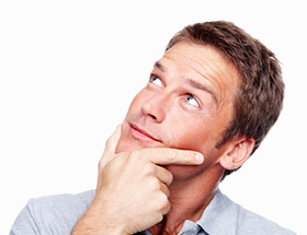 man holding chin looking into air