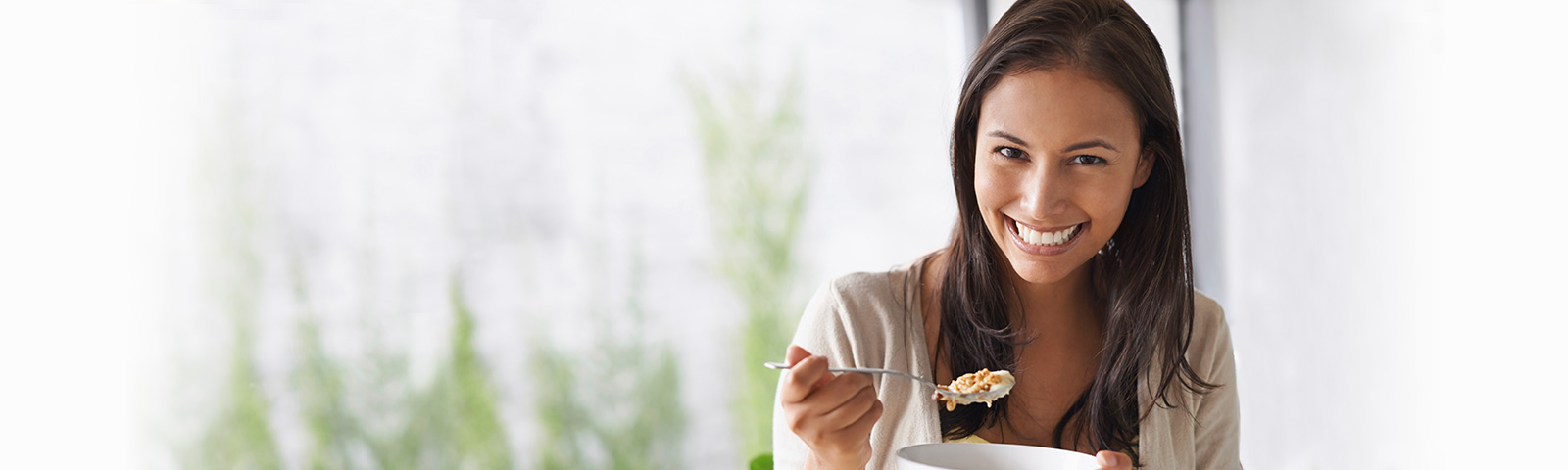 smiling woman with cereal