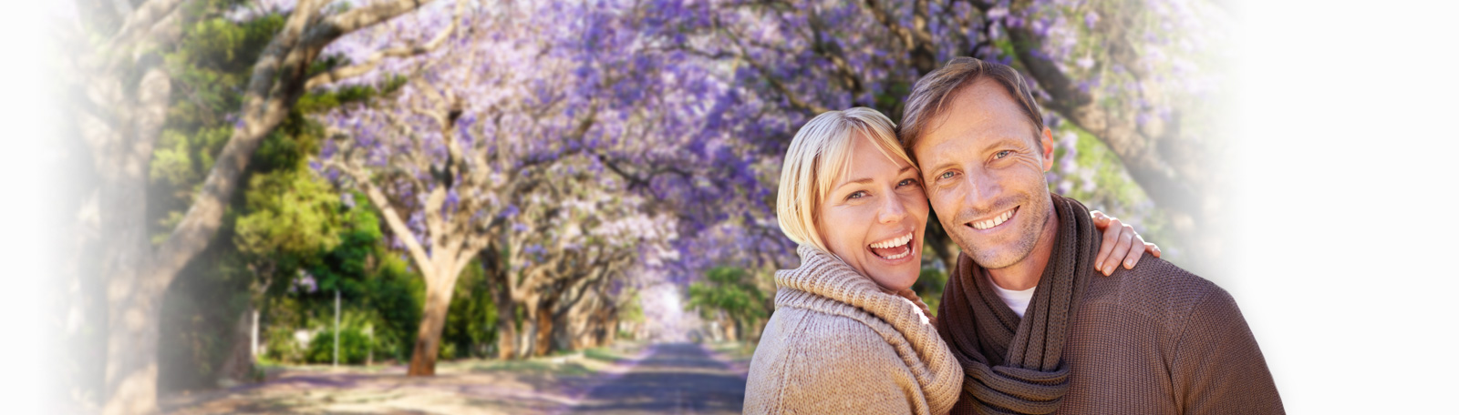 couple in front of jacaranda plant