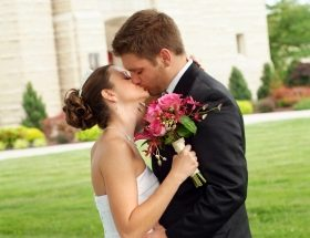 single man and single women kissing on wedding day