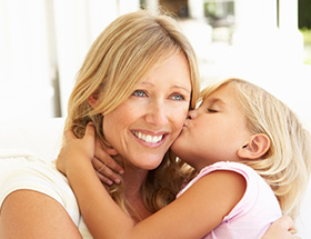 blonde woman with small child